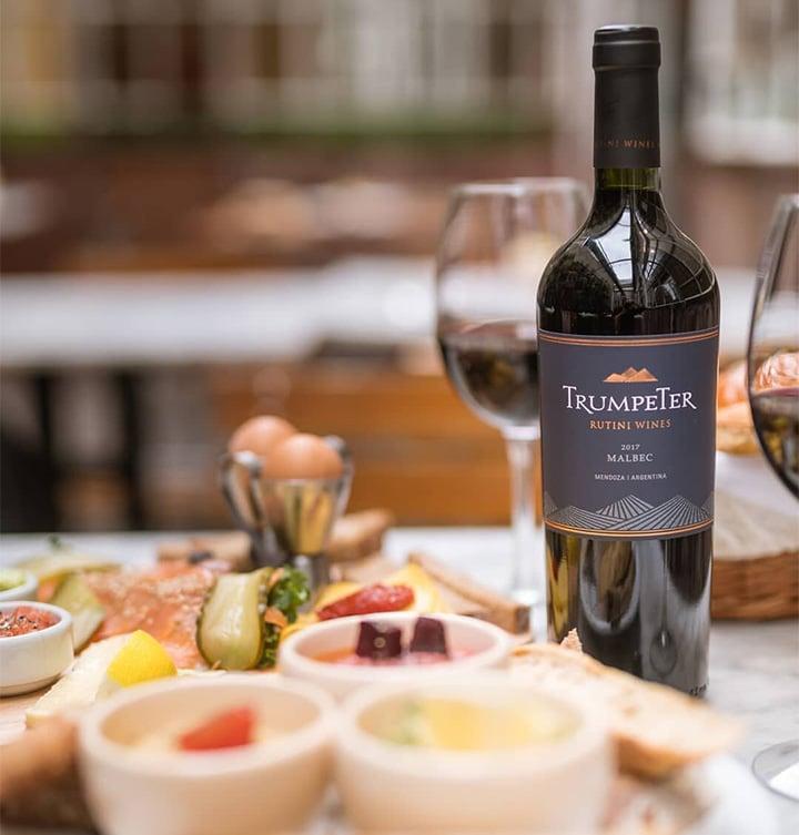 Trumpeter, a popular Malbec wine from Mendoza in Argentina, alongside an antipasti platter