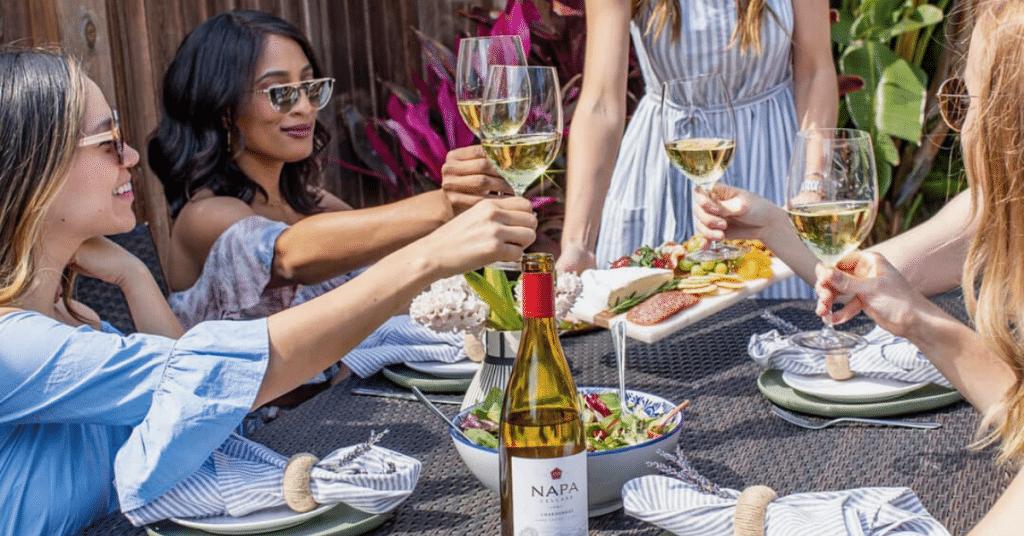 A group of ladies raising glasses and enjoying the Napa Cellars Chardonnay