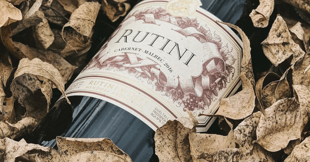 A bottle of Rutini Cabernet Malbec on the ground