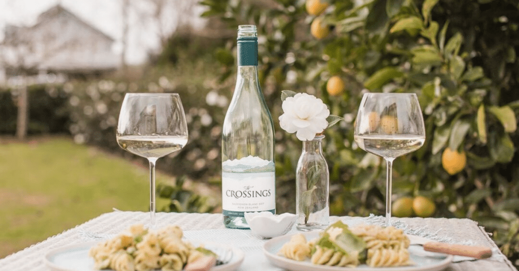 The Crossings Sauvignon Blanc on a table paired with a light dish